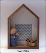 A young girl holds a baby in this photo frame that was made to celebrate the birth of my nephew/