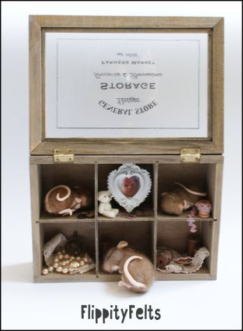 Three sleeping mice in a vintage-style chest