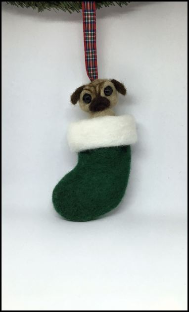 felted pug in a stocking